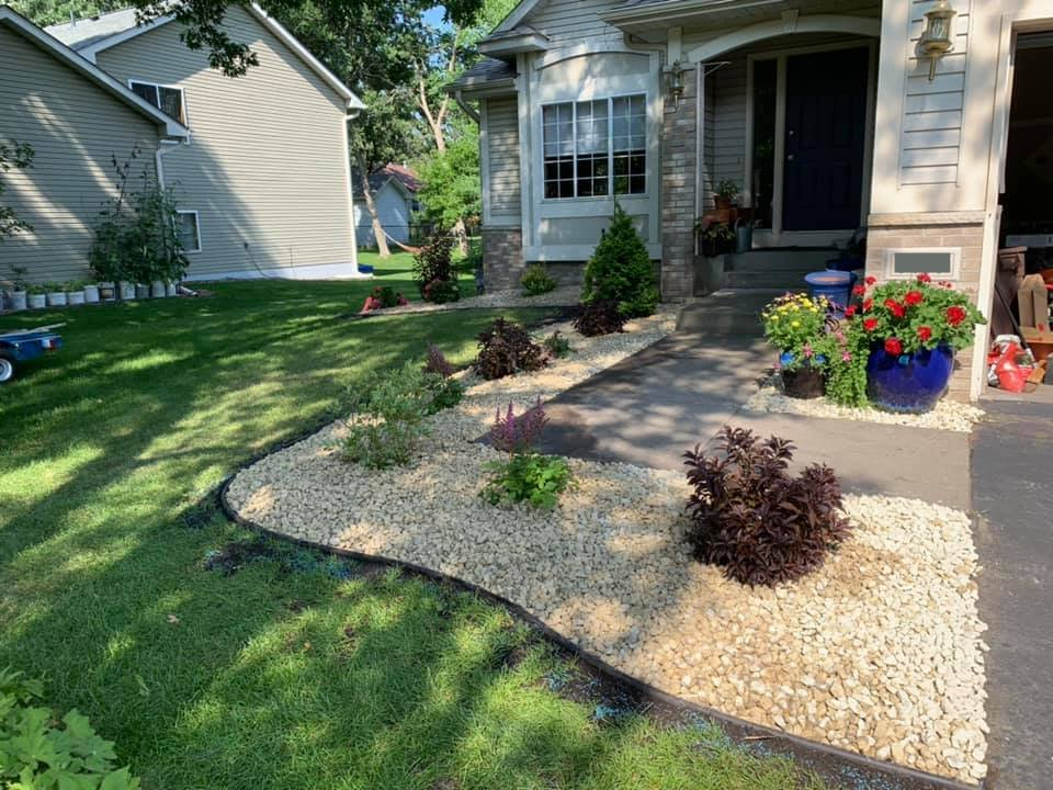 shrubs and decorative rock landscaping Loretto MN