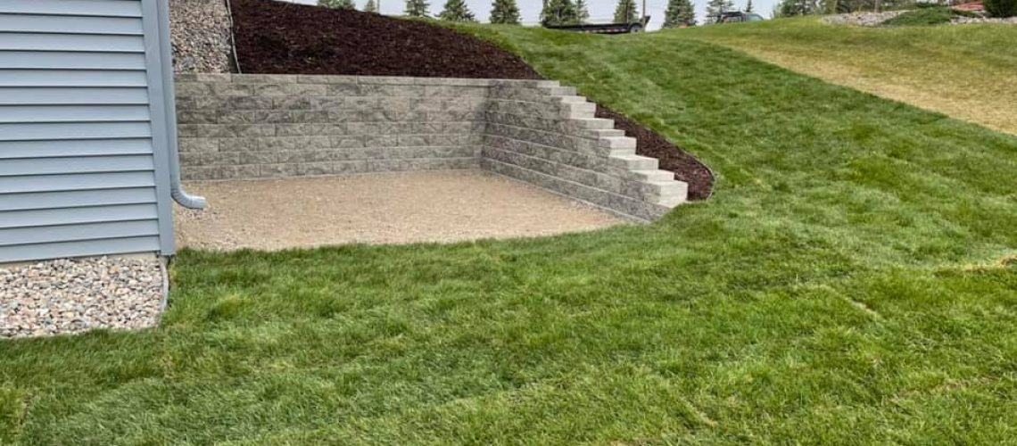 new sod, mulch and block retaining wall in Maple Grove MN
